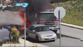 Trash truck catches fire, slams into home
