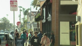 Dozens flock to Huntington Beach as OC businesses reopen