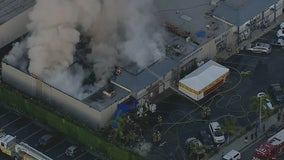 Crews battling large fire at Orange County strip mall