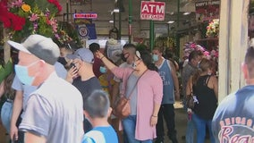Crowds ignore social-distancing, scramble for flowers this Mother's Day