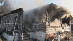 Man arrested on suspicion of arson after fire destroys Westminster mobile home; 2 injured
