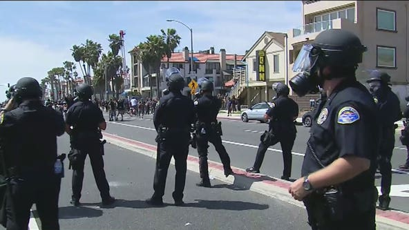 Police: Protest in Huntington Beach declared an unlawful assembly