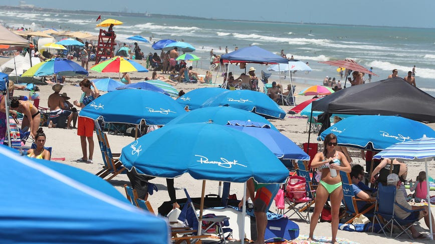 Memorial Day weekend draws crowds, triggers warnings of virus resurgence as US death toll nears 100,000