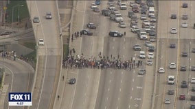 Group of protesters block 405 Freeway in West LA