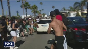Car careens through crowd of peaceful protesters in Newport Beach; driver in custody