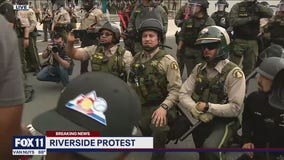 Riverside County Sheriff Chad Bianco and his deputies take a knee in support of protesters