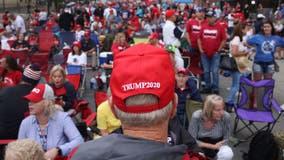 Metal barriers, Trump gear: Crowd readies for Tulsa rally
