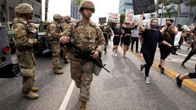 California governor: Cities should end use of National Guard