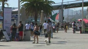 People flock to the beach in the scorching SoCal heat