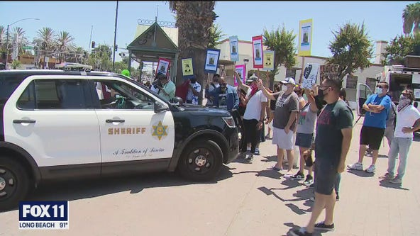 Protesters in support of Andres Guardado remain peaceful as they rally outside Compton's Sheriff Station