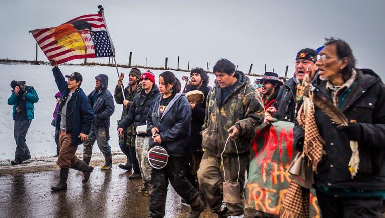 Defiant Dakota Access Pipeline water protectors faced-off