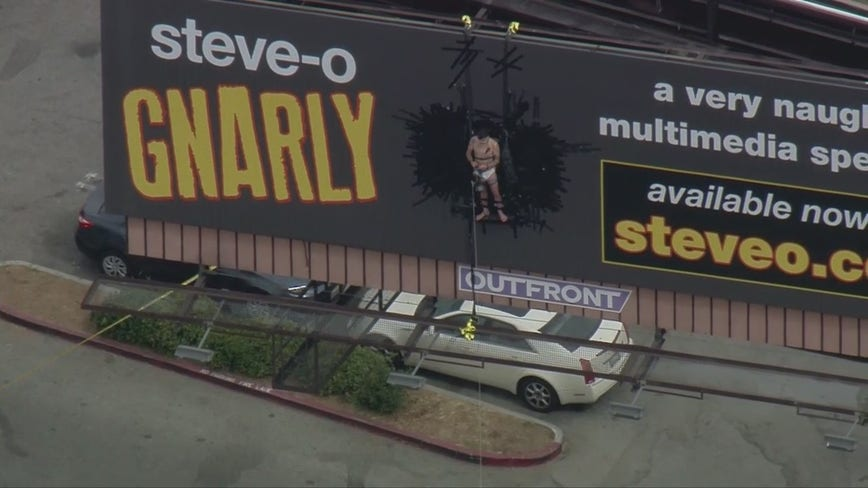 LAFD responds to unusual call for service after man tapes himself to billboard in publicity stunt