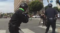 LAPD footage shows officer shooting protester in groin with less lethal bullet