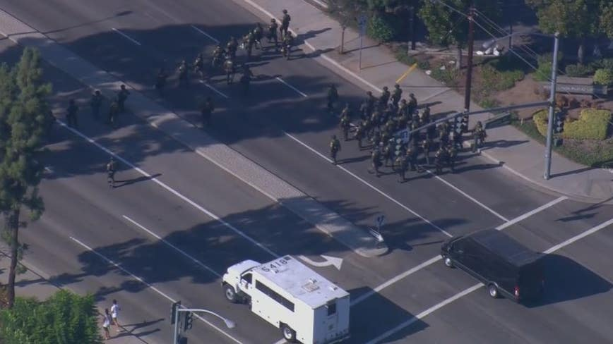 Driver arrested after striking two people with her car at Yorba Linda BLM protest