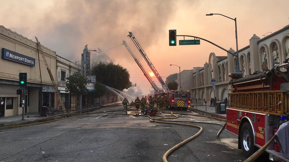 Fire Ravages Housing Complex Historic Theater In East Los Angeles