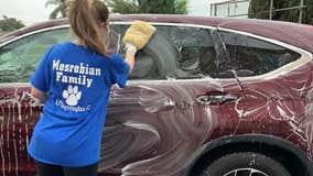 High school students organize car wash