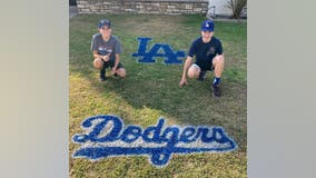 Brothers show their Dodgers spirit spray painting team logos on lawns across Southern California