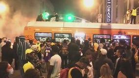 76 arrested, 8 officers injured after Lakers celebration turns violent outside Staples Center