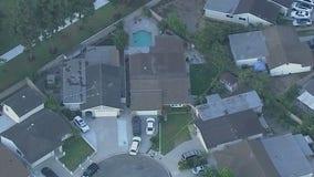 Three men found dead in backyard of Norwalk home