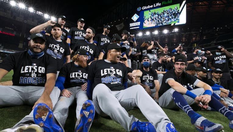 Dodgers celebrate with a team photo on the field