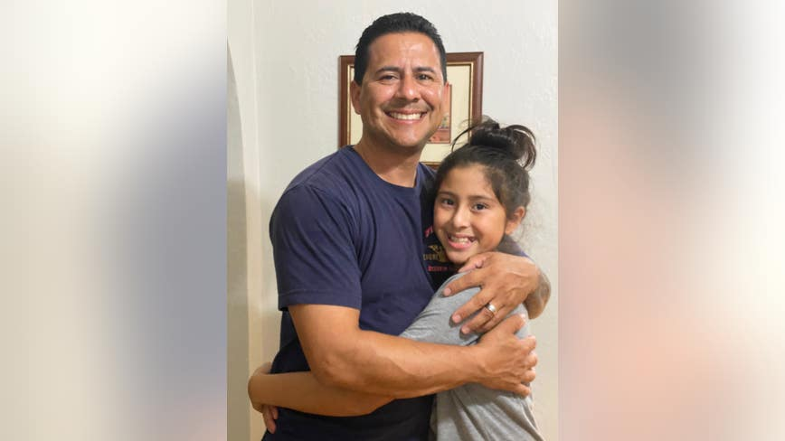 Daddy's little girl: Emotional reunion with 10-year-old and firefighting father
