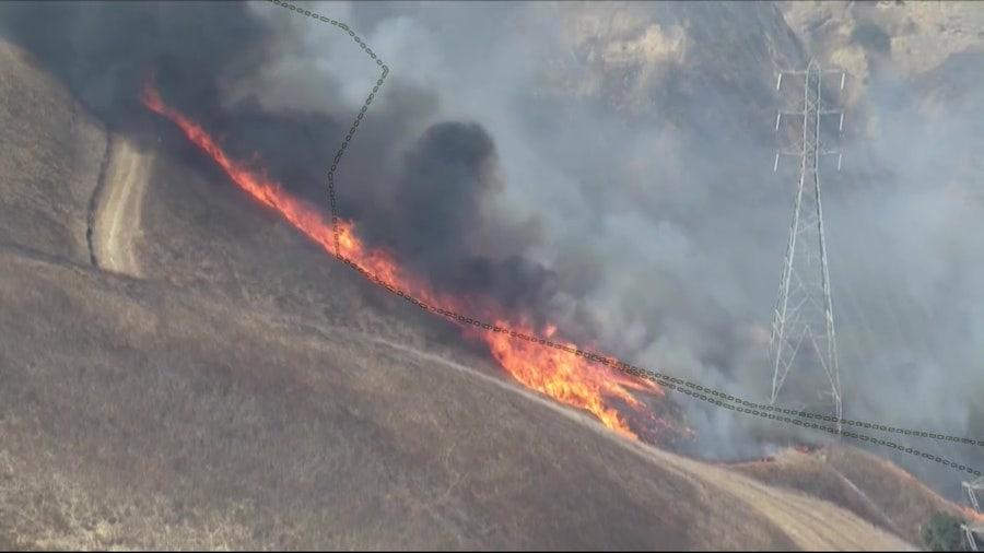 Wind-driven Blue Ridge Fire on west end of Corona spreads into Orange County