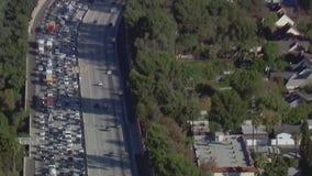 Car fire snarls traffic on 405 Freeway through San Fernando Valley