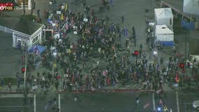 Hundreds gather in Huntington Beach to protest state curfew