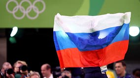 Russia banned from using its name, flag and anthem at next 2 Olympics