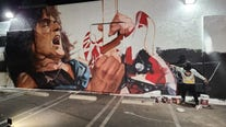 Artist inspired by 'Mamba Mentality' in painting Eddie Van Halen mural