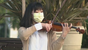 Neighbors stop to catch woman play violin in West LA