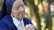 COVID-defying French nun toasts 117th birthday with wine and prayer