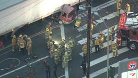 One dead, another injured after car collides into semi-truck in downtown LA