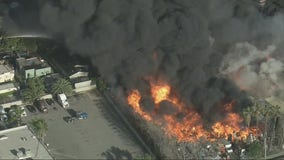 Massive fire breaks out at a pallet yard in Compton