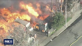 Several homes destroyed after massive fire breaks out at a Compton pallet yard
