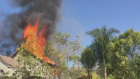 Firefighters battle blaze at Laguna Hills house where suspect was barricaded
