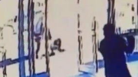 Asian woman brutally attacked in NYC as security guard watches and closes door