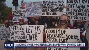 High school cheerleaders protest in Riverside over state's ban on sideline cheerleading