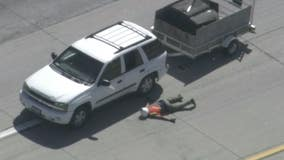 Man arrested in Fontana after slow-speed pursuit on 210 Freeway in SUV hauling a trailer