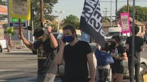 Demonstrators show 'togetherness' at Florence and Normandie after Chauvin guilty verdict