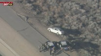 Wanted murder suspect in standoff with officers