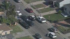 Son arrested after investigators find mother's body inside trash bin in Walnut Park area