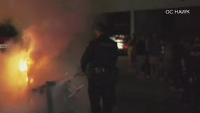 Two taken into custody at UCLA for setting fires after loss in national semifinal game of the NCAA