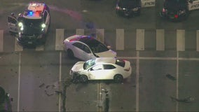Driver in custody after refusing to get out of car after chase, crashing suspected stolen car in Beverly Hills