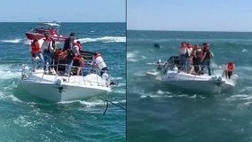 14 rescued as boat sinks near Newport Harbor