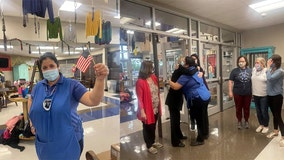 Elementary students, staff cheer for cafeteria manager who passed US citizenship test