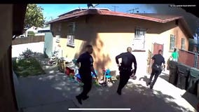 Dramatic video shows Bell Garden police officers escorting people out of burning home