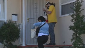 Community members go door-to-door to encourage South LA residents to get vaccine