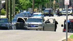 Four Alabama officers hurt after argument over dog ends in deadly shooting