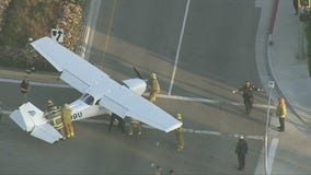 Crews move small plane from busy intersection on 101 Freeway